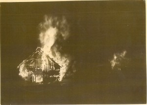 Photograph looking in the north entrance early in the fire. The flames in the distance are at opposite end of the 160' x 180' building. (Waterbury Historical Society)