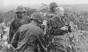 BG Merritt A. Edson, (with binoculars) assistant division commander of the 2d Marine Division, follows the progress of his troops not far from the scene of action. Gen Edson was awarded the Medal of Honor for his heroism on Guadalcanal.— Department of Defense Photo (USMC).