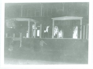 Gwen Miller's photo showing the fire starting in the area of the lobby. Note the ghostly images of three people coming down the steps and escaping. (Waterbury Historical Society)