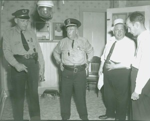 Law enforcement officials meet in the kitchen of the Mansfield house. Left to right: Essex Chief Clarence McCloud, Winooski Chief Charlie Barber, Chittenden County Sherriff Dewey Perry and State's Attorney Clarke Gravel.