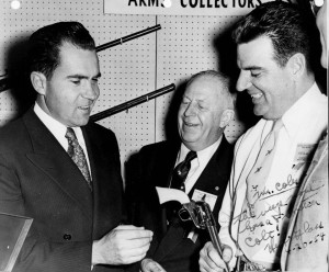 An autographed photo of Richard M. Nixon accepting a Frontier Colt revolver from Herb Glass while Major General Merritt Edson of the NRA watches. - Credit National Rifle Association 1600 Rhode Island Ave., N.W Washington, D.C.
